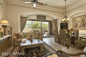 Classic entertaining with custom window treatments and superb views.