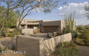 Enjoy your secluded driveway with desert landscaping.