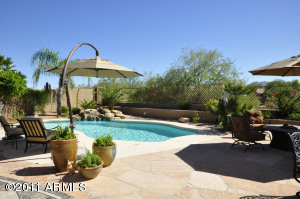 Resort-style, private backyard with huge patio and rock waterfall pool. Terrific mountain and desert vista views, including lawn and children's play areas.