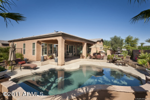 Gorgeous pool is just one element of the stunning backyard paradise you'll enjoy in your beautiful home. Short fence around pool, installed to keep small blind dog from pool, is easily removed.
