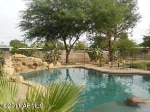 Host the best pool parties ever! $75K+ pool & spa added in 2007. All the upgrades - pebblesheen, in-floor cleaners, custom tile inlays, jump/table rock on huge baja shelf, loveseats, oversized waterfall, swim-up bar w/ 4 stools, etc!