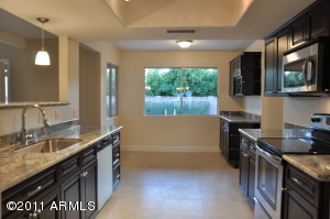 Standing in your beautiful kitchen you can see right out to the lush backyard!
