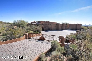 Spellbinding mountain vistas and peaceful desert serenity surround this spectacular custom home sited on over an acre in North Scottsdale.