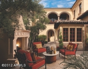 The Villa 13 Courtyard is an entertainers delight, complete with easy access from the kitchen, family room, and other rooms, a cozy fireplace for those cool desert nights, plenty of space for seating, & trees for shade & privacy.