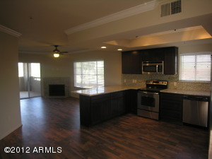 Open Kitchen with sit down breakfast bar, dramatic re-design and remodel from original.