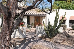 Tall shade trees, an inviting courtyard and a large picturesque lot welcome you to this beautiful home in the Magic 85254 Zip Code.