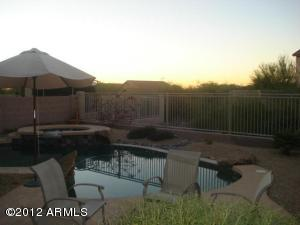 Features pool, spa, gas fire pit, and TV bracket & wiring.