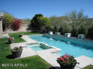 Lushly landscaped back yard with nice size heated pool & spa and wonderful mountain views!
