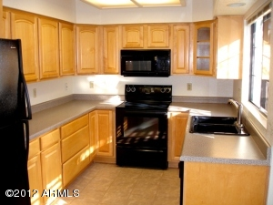 Expanded kitchen with upgraded maple cabinets,including pot drawers; black appliances incl smooth cooktop, refrigerator & built-in microwave