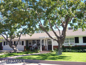 GREAT CURB APPEAL...Charming English garden landscape,mature trees