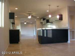 This kitchen offers a huge area to entertain joined by a formal dining room on one side and media/great room on the other.