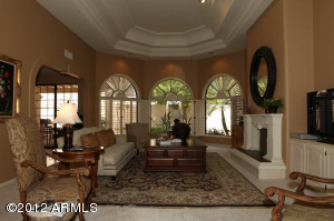 18 ft high vaulted beautiful ceilings and dramatic fireplace.
