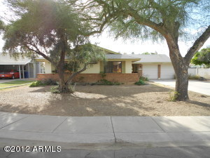 EZ maintenance desert front and plenty of bacyard area for gardening, pets and children.
