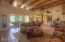 Living Area with triple 144' sliding doors overlooks covered Patio with 2 skylights.