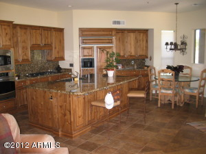 Updated Kitchen w Large Island Granite Counter tops and backsplash