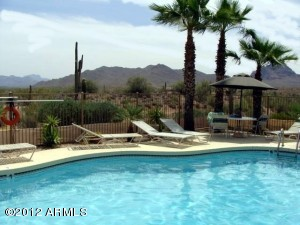 Enjoy the Heated Pool and Spa Overlooking Open Desert with a view of Four Peaks.