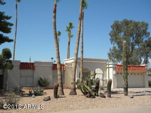 Charming Spanish-style 3 bedroom, 2 bath move-in ready home located in a great community centrally located in Scottsdale