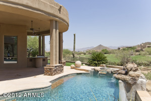 Pebble Tec Pool with Large Rock Waterfall and Perfect Golf Course Views.