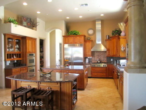 Spacious, flowing kitchen w/views from expansive window of mountains.