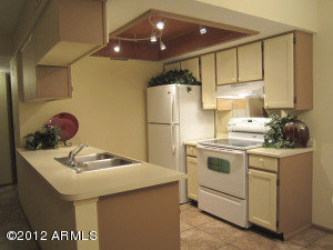 Attractive Kitchen. Smooth Top Range. Refrigerator. Dishwasher.
