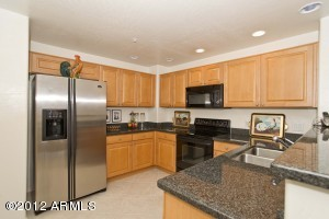 Lovely upgraded Kitchen with Granite Counter Tops and stainless steel appliances. Loads of Maple cabinets deliver ample storage space. You also have a nice-sized pantry, next to a room/doored-space for the washer and dryer.