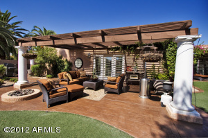 Your own resort oasis, complete with pool, waterfall, gas firepit...lush and open.