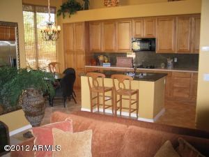 Combo of Kitchen w/kitchen table and family room looking at south facing patio.