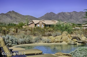 Imagine relaxing by the pool with these big McDowell Mountain views.