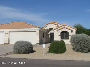Front of Home with desert landscaping