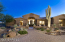 Note the stacked stone accents. Courtyard features travertine pavers.