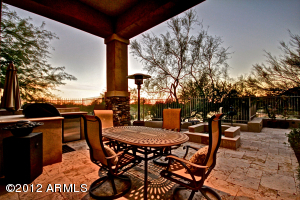 Welcome to this beautifully updated, lakefront Tapadero Villa located in the prestigious guard-gated Country Club at DC Ranch. The backyard is perfect for relaxing and taking in the breathtaking views of the lake, city lights, and gorgeous Sonoran sunsets. Take advantage of this rarely available beautiful waterfront setting in DC Ranch. Home furnishings can be purchased on a separate bill of sale for a turn-key home.