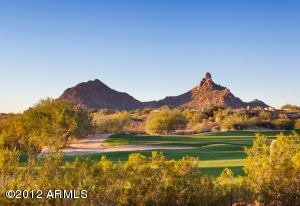 The home is located on the 10th Green of Troon Country Club golf course with views to Pinnacle Peak and the valley below.