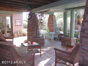There are great areas all around for entertaining or just relaxing out doors. This is the extended covered patio near the pool and spa.