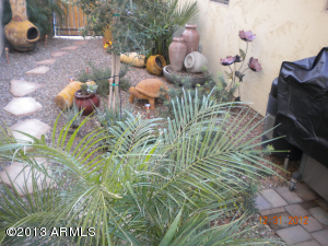 Beautiful side yard sitting area with nice pavers.