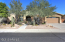 Front of home, desert trail across from home, open area
