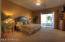Master Bedroom downstairs with separate exit to backyard