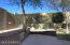 Backyard with privacy fencing and Stainless Steel barbeque