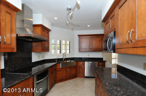 Completely remodeled kitchen with granite, stainless and new cabinetry!