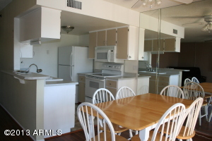 Convenient kitchen with breakfast bar and eat in dining area