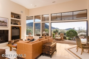 Opens to the patio and pool with views to city and mountains (and great sunsets, of course).
