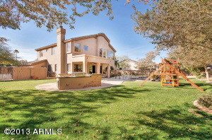 This is your dream backyard!! A gourmet outdoor kitchen, a play area, fenced pool and plenty of space on this lot that is over 18,000 square feet.