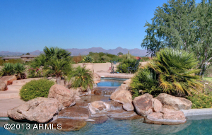 Views of Pinnacle Peak and the McDowell Mountains that are endless; add Scottsdale City Lights for nighttime enjoyment.