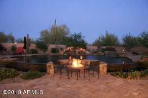 This custom pool will wow you everytime you walk into your backyard. If you dont feel like sitting around this beautiful firepit move just a few feet away and you have a cozy wood fireplace nothing has been overlooked in this showplace.