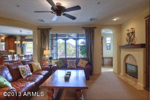 Great room floor plan - family room open to kitchen and office nook. Family room features a fireplace, built in entertainment center, custom drapery and mountain views!