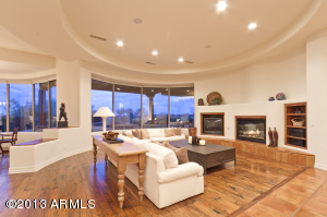 Open and flowing great room floor plan with an abundance of windows to capture golf course and mountain views.