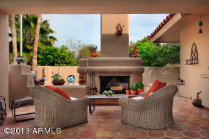 Very Cozy, inviting area under covered rear patio with great fireplace. Real Arizona living!!