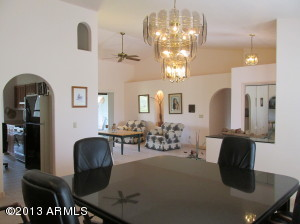 Dining room, living room and kitchen through the arch.