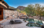 Negative edge lagoon pool with spa and waterfall that pours over into wash below. Built in gas barbecue.