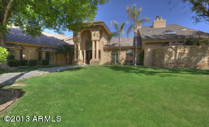 Gorgeous grassy lawn leading to grand, columned entry.