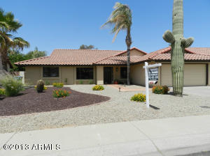 Charming home in desirable area with tiled walkway and easy care desert landscaping.